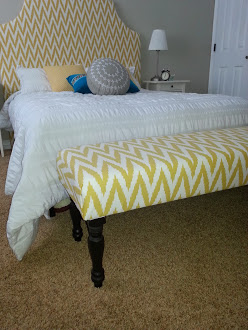 How to make an upholstered bench for the foot of your bed. Tutorial at Sawdustsisters.com