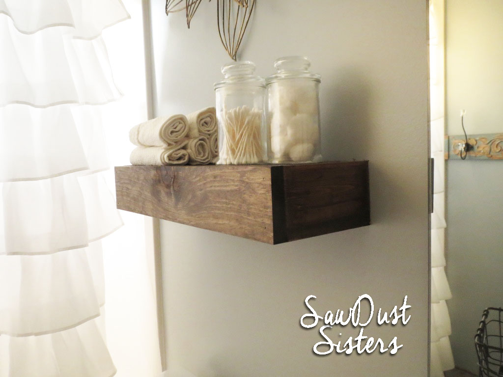 Easy DIY Bathroom Floating shelf. Tutorial at Sawdustsisters.com