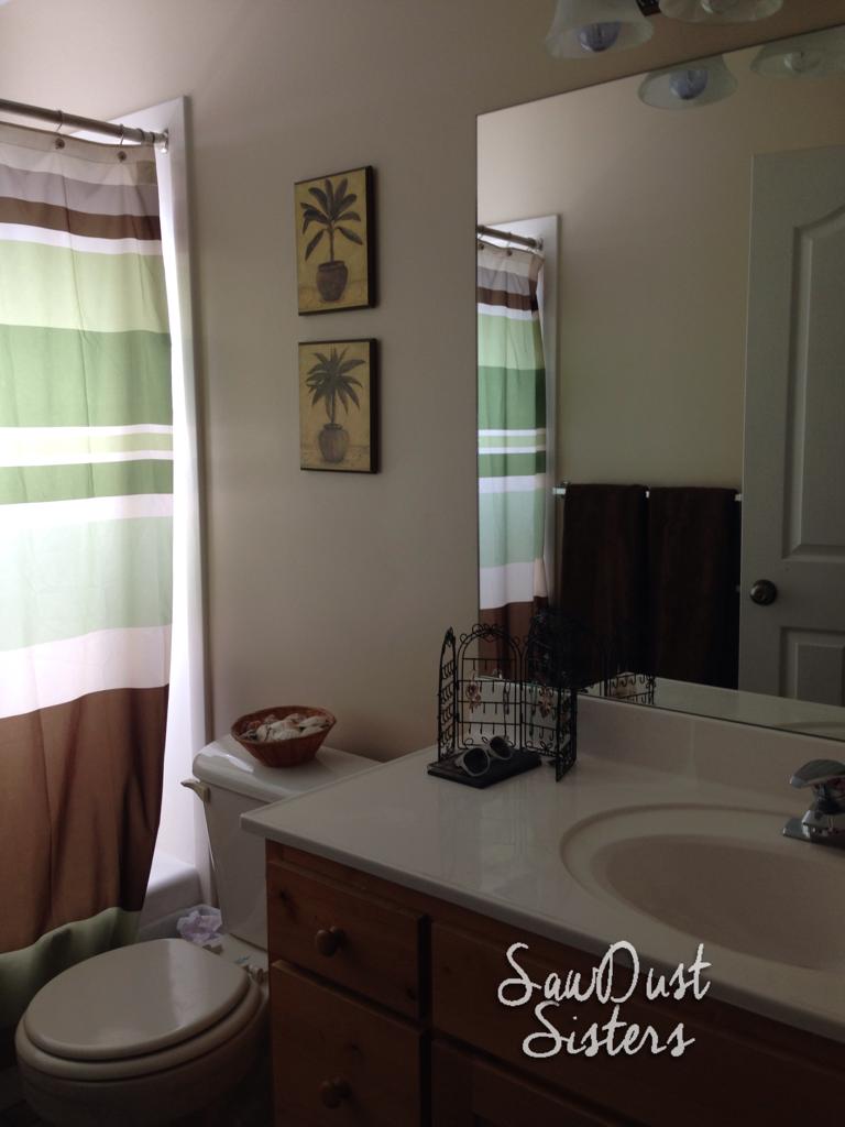 Easy DIY Bathroom Floating shelf. Tutorial at Sawdustsisters.com