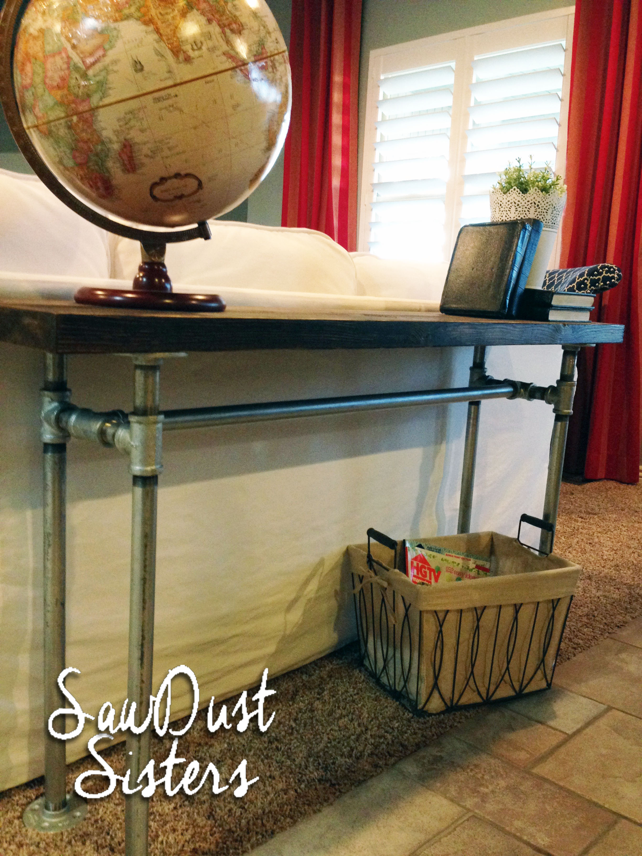 easy diy sofa table with pipe frame sawdust sisters. Black Bedroom Furniture Sets. Home Design Ideas