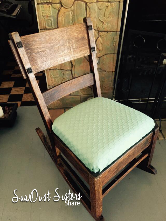 Make an old chair pretty again! Reupholstery tutorial at Sawdustsisters.com