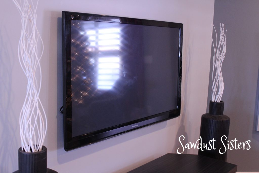 how to mount a flat screen tv and hide cords inside the wall sawdust sisters. Black Bedroom Furniture Sets. Home Design Ideas
