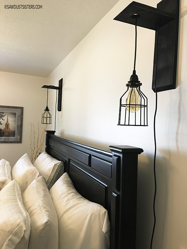 above the bed wall sconces