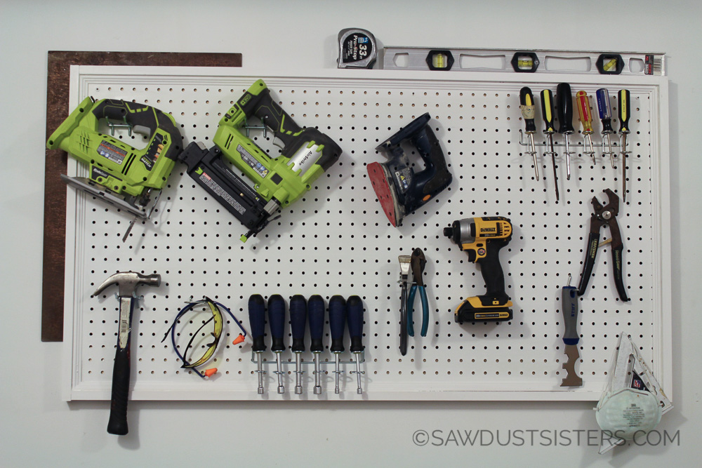 Hanging a pegboard the EASY WAY. No need for your hubby to help.