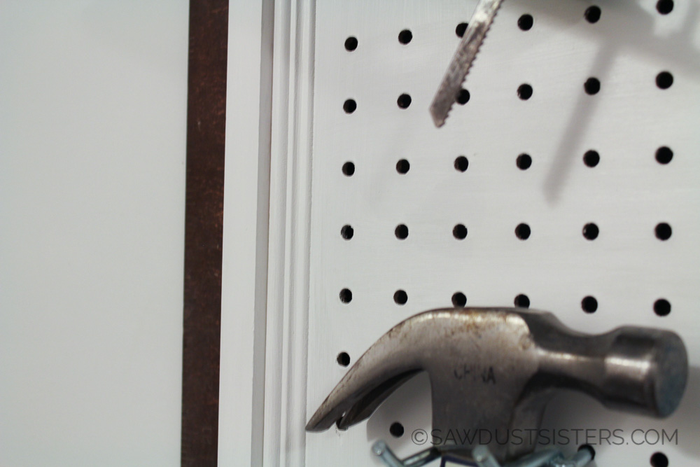 How to hang and frame pegboard. Easy enough I think I'll try it and surprise my husband!