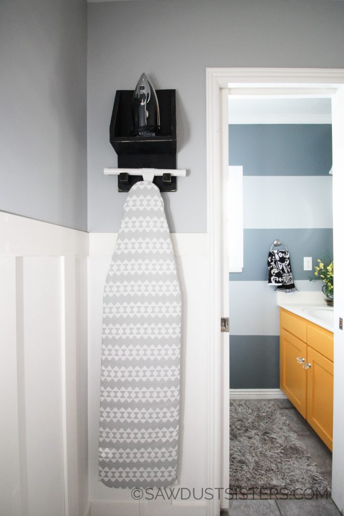 Get some ideas for a small laundry room and powder room. This DIY ironing board holder is SO cute!