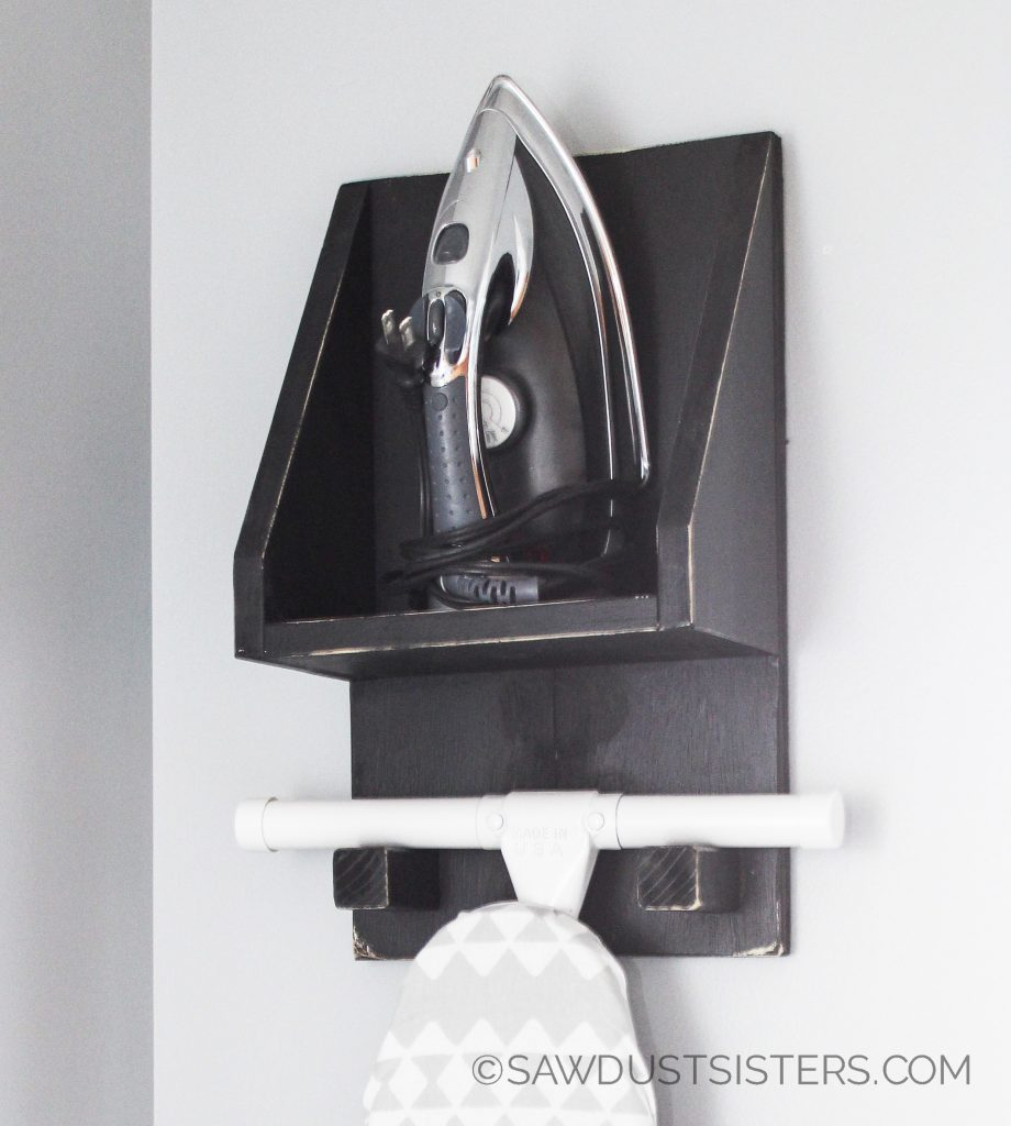 Build a simple DIY Ironing Board Holder with a shelf to store your iron and ironing supplies!