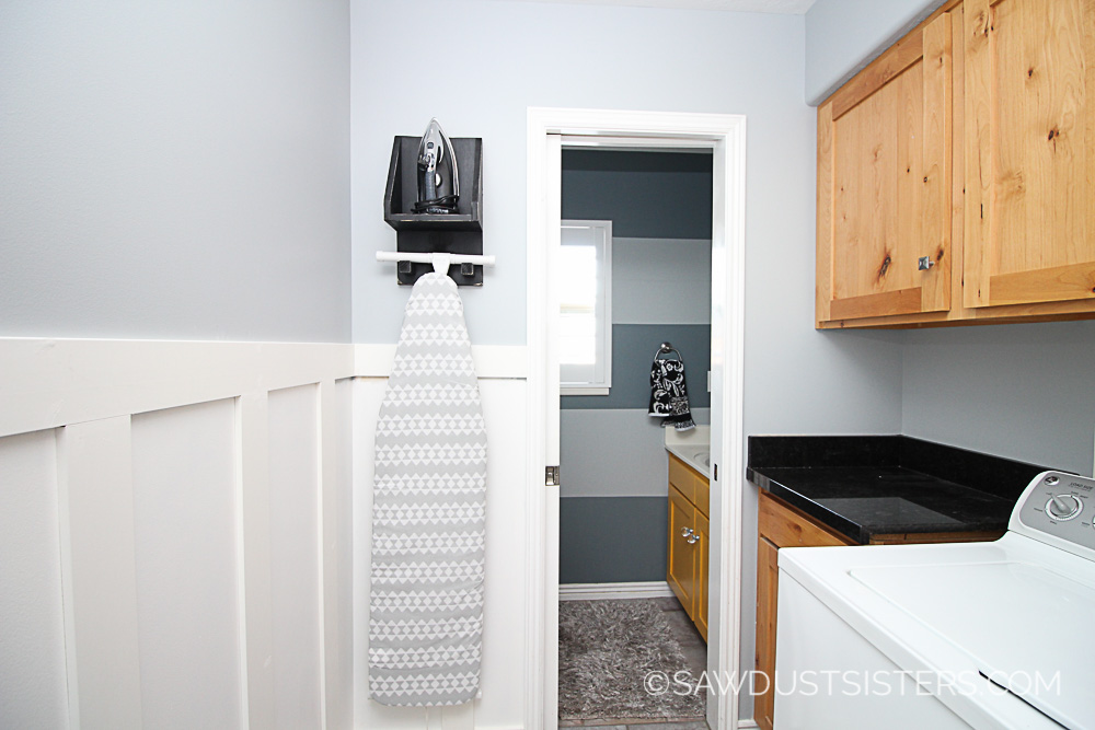 Faux wainscoting panels for a small laundry room. You will be surprised at how EASY it is to create this look.