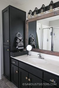 If you are looking to update your bathroom with a unique touch, consider a black vanity. The sleek look adds a neutral, yet modern feel to any bathroom. The vanity in my master bath is large, and I was skeptical about painting it, but once finished, the black color was the perfect choice to update this 90's bathroom on a small budget.