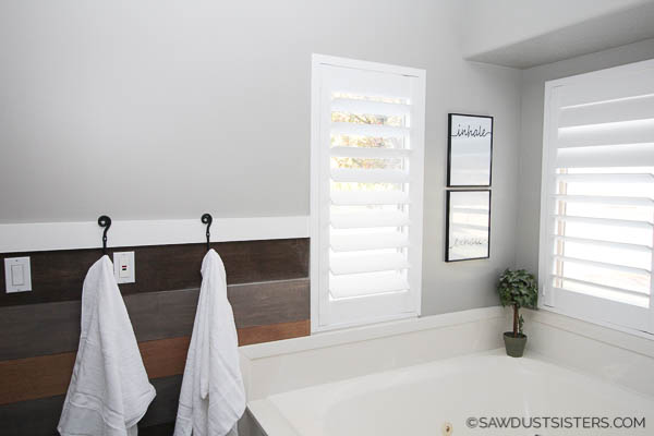 If you are looking to display your towels with a unique touch, consider a DIY towel rack treatment. The modern farmhouse look adds a neutral, yet updated feel to any bathroom. This 90's master bath has been getting a budget-friendly update for the past year. Click to find easy ways to incorporate some of the same ideas in your own space!