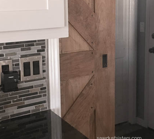 Learn how to install a finger pull on a sliding barn door, using a chisel. Adding a finger pull  is a sleek way to enhance a piece with functional hardware while minimizing bulk.