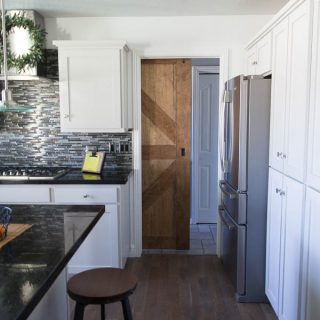 """This beginner- friendly tutorial is a for two sided barn door with rustic decorative trim on both sides. Use wood boards from the big box store and birch plywood for a budget friendly project. This project lays out the steps to build a door of any size while still keeping the 1- 3/4"""" door width required by standard sliding barn door hardware. #sawdustsisters #barndoor #slidingbarndoor #doublesidedbarndoor"""