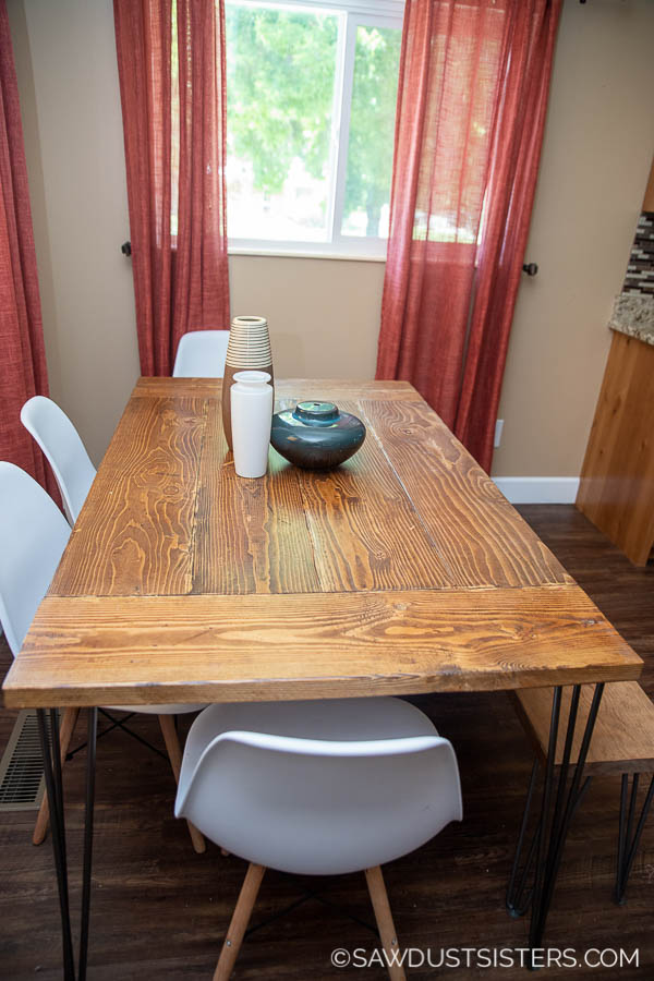 This tutorial is for a small DIY Modern Farmhouse Dining Table for beginners. The planked top makes the project adjustable to any table length, and do-able with inexpensive lumber. The gorgeous (and sturdy!) hairpin legs add a modern touch. Click for a detailed tutorial!