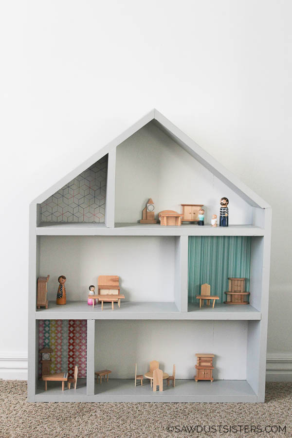 This simple DIY handmadewooden dollhouse makes a great gift. Build it with inexpensive lumber and a few tools. Click for a step-by-step tutorials and free plans.