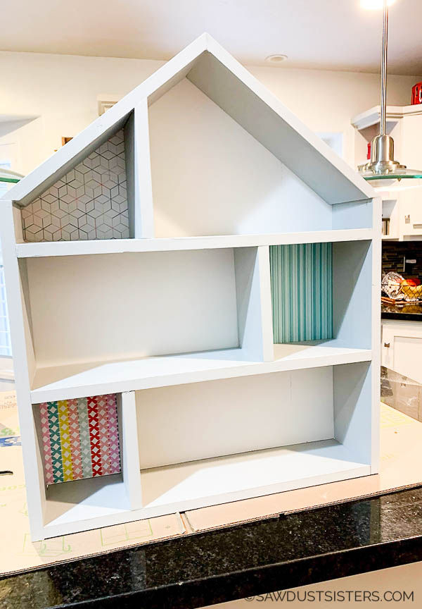 This simple DIY wooden dollhouse makes a great gift. Build it with inexpensive lumber and a few tools. Click for a step-by-step tutorials and free plans.