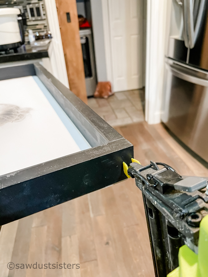 Learn a quick and easy way of framing large posters or photos with this step-by-step tutorial. No tools? No problem. Have your wood cut at the home improvement store and you'll be ready to go.
